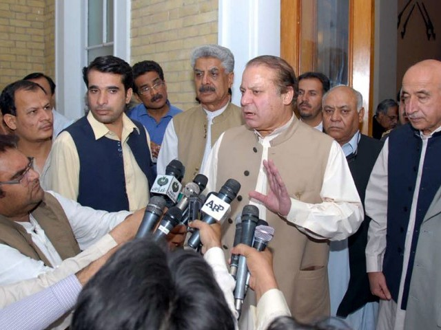 Prime minister Nawaz Sharif addressing the media outside the Governor house in Quetta on Tuesday flanked by Balochistan chief minister. PHOTO: PID