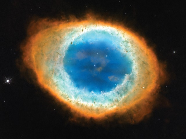 The Ring Nebula as captured by the Hubble Space Telescope. The whole structure in the photograph is about one light year across. SOURCE: NASA, ESA, AND THE HUBBLE HERITAGE (STSCI/AURA)-ESA/HUBBLE COLLABORATION