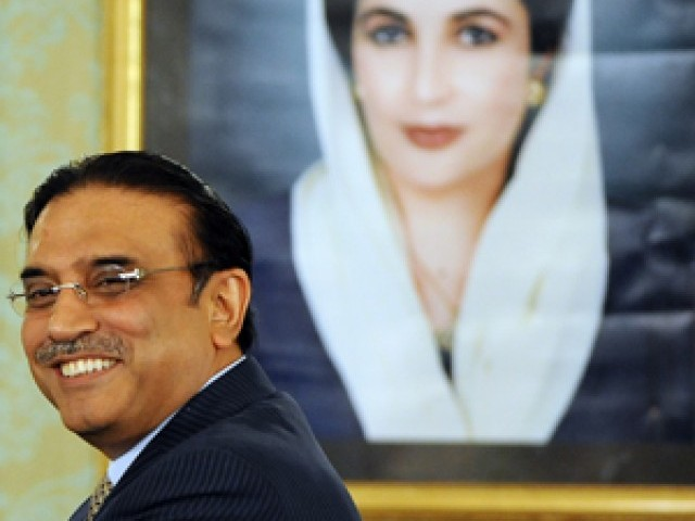 File photo of President Zardari in front of Benazir Bhutto's portrait. PHOTO:EXPRESS/FILE