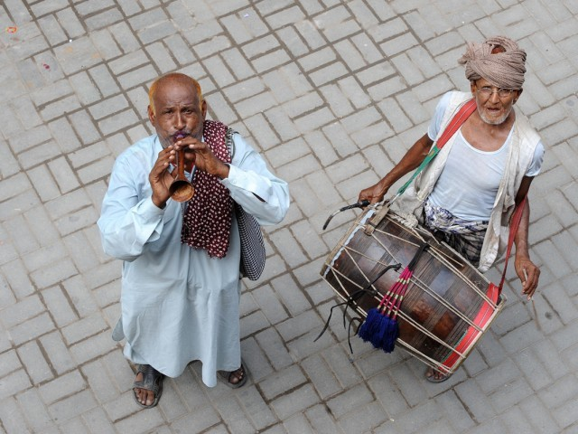 """The tradition of drummers in cities has nearly vanished. It is barely surviving in small villages or neighbourhoods where people sleep on terraces and can easily hear a shout from the street,"" says a drum beater. PHOTO: Express/File"