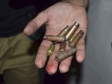 A security official displays shells to the media at the site of a shooting attack in Quetta July 15, 2013. PHOTO: REUTERS