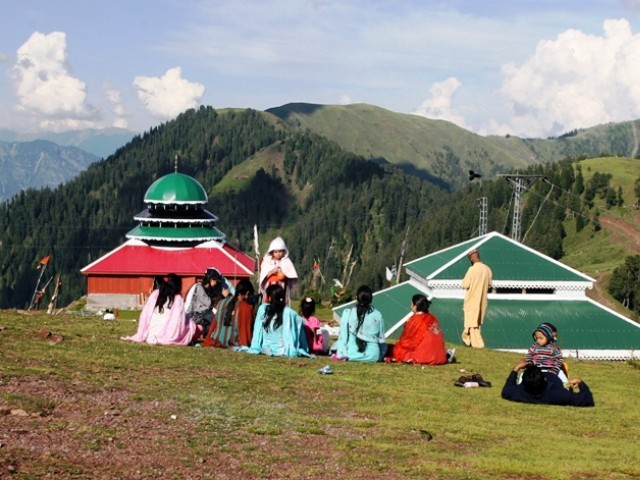 In this photograph taken on June 16, 2013, tourists gather in the mountainous Neelum valley in Kashmir. PHOTO: AFP