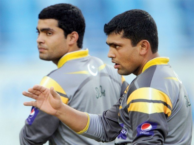 Kamran Akmal wants younger brother Umar to focus on his batting and make it a priority over wicket-keeping. PHOTO: AFP