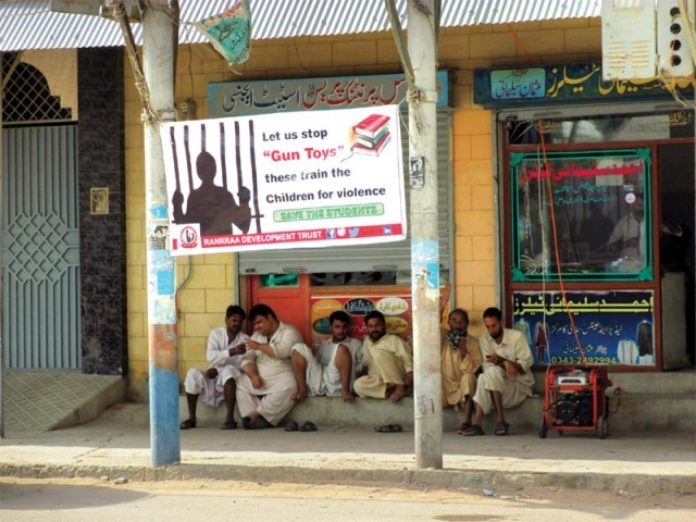NGO Ranrraa is working primarily in Pashtun-majority neighbourhoods to create awareness on the adverse effects of letting children play with toy guns. They have put up banners across the neighbourhood so parents do not buy guns for their children, who insist on buying them for Eid. PHOTO: ATHAR KHAN/EXPRESS & RANRRAA