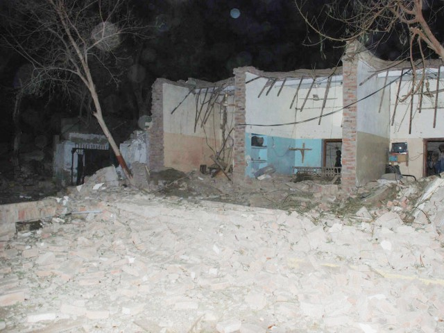 The first blast occurred when militants reportedly rammed an explosive-laden truck into one of the houses. PHOTO: EXPRESS/NAEEM AHMED GHOURI