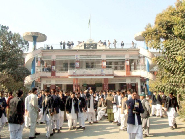 Students seeking admission stand outside Government Jahanzeb College. PHOTO: EXPRESS