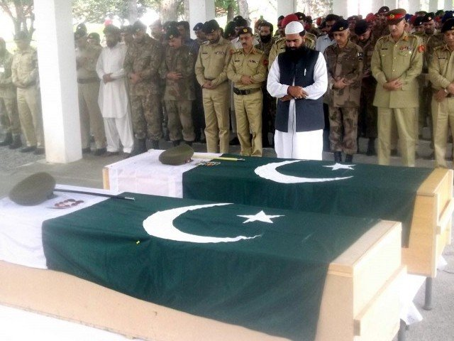 Army officials offering the funeral prayers of Pakistan Army' Colonel Mustafa and Captain Ashfaq. PHOTO: INP