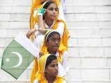 Students wait for their turn to perform national songs at a ceremony to celebrate the country's 67th Independence Day at the mausoleum of Muhammad Ali Jinnah in Karachi August 14, 2013. PHOTO: REUTERS