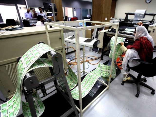 A worker of the National Database and Registration Authority (NADRA) checks newly printed government identity cards of registered citizens at the NADRA head office in Islamabad November 14, 2012. PHOTO: FILE