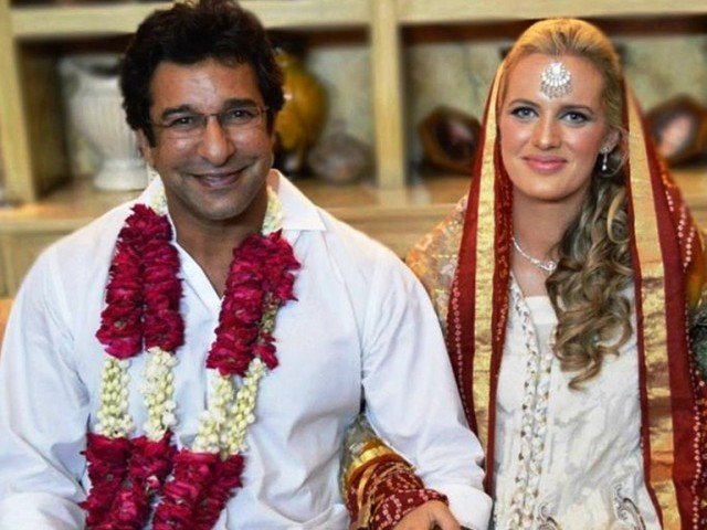This handout photograph provided courtesy of Wasim Akram shows former Pakistani cricket captain Wasim Akram posing with his Australian bride Shaniera Thompson during their wedding ceremony in Lahore on August 12, 2013. PHOTO: AFP