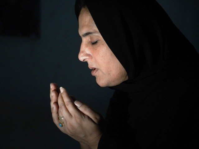 This photograph taken on April 5, 2013 shows transgender Sanam Faqeer, an independent candidate for Pakistan's forthcoming general elections, offering prayers at her residence in the southern city of Sukkur. PHOTO: AFP/FILE