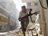 a-free-syrian-army-fighter-takes-cover-during-clashes-with-syrian-army-in-the-salaheddine-neighbourhood-of-central-aleppo-2-2-2-2-3-2-3