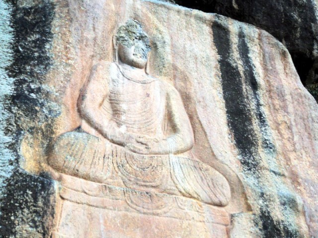 A rock carving of Buddha at Jahanabad. PHOTO: FAZAL KHALIQ / EXPRESS