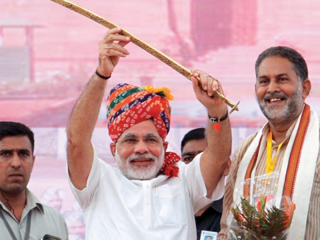 Gujarat Chief Minister Narendra Modi raises a sword at Bharatiya Janata Party rally after being named a prime ministerial candidate for elections due next year. PHOTO: AFP