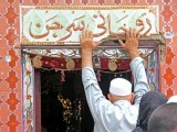 Most of the people who visit the shrines of Roohani Surgeon (above) and Jalali Shah Baba believe in miraculous recoveries. PHOTOS: AYESHA MIR/EXPRESS