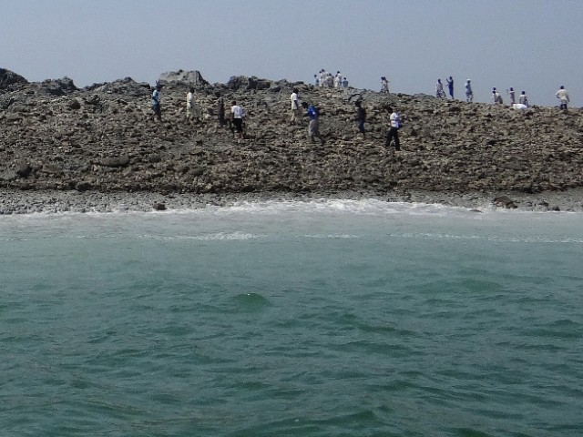 People scrambling to explore the new island. PHOTO: AFP/FILE