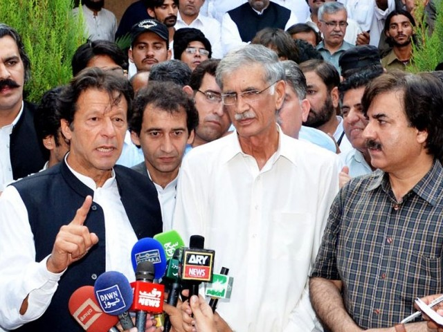 Chairman PTI Imran Khan along with Chief minister K-P Pervez Khattak talking to media. PHOTO: ONLINE