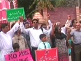 Screengrab of muslims outside St Anthony's church during Sunday mass.