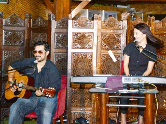 Siblings Maria and Danish, an upcoming indie duo, perform various covers with their guitars and keyboard. PHOTO: EXPRESS