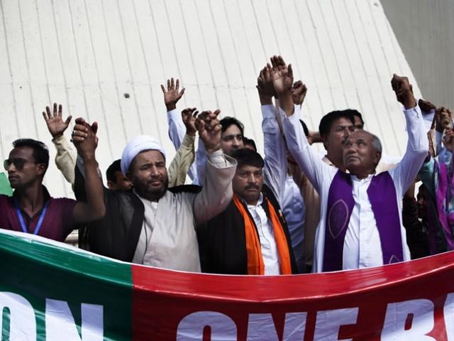 The church pastor joins hands with ulema from the Shia and Sunni sects. PHOTO: MYRA IQBAL/EXPRESS