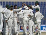 Pakistan's team celebrates South Africa's JP Duminy out during the fourth day of their first Test at the Sheikh Zayed Cricket Stadium in Abu Dhabi on October 17, 2013. PHOTO: AFP