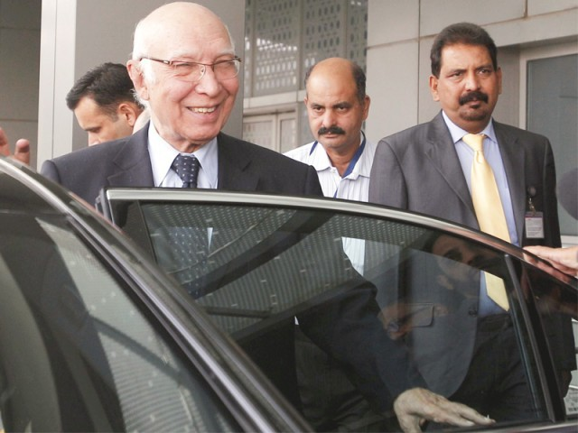 Sartaj Aziz exits the ceremonial lounge following his arrival at the Indira Gandhi International Airport in New Delhi. PHOTO: AFP