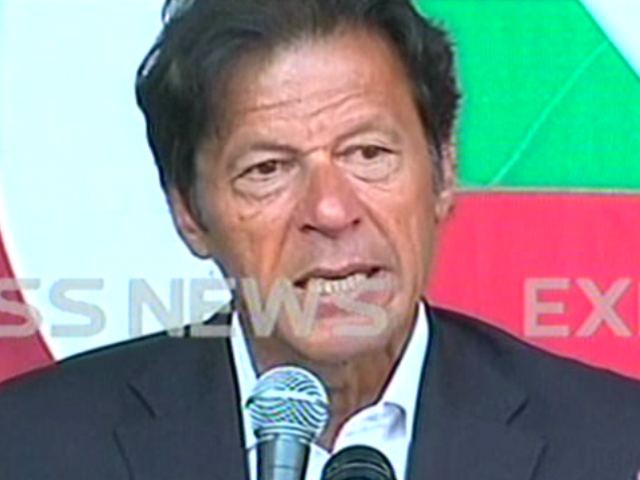 Express News screengrab of Imran Khan speaking at a press conference in Islamabad.