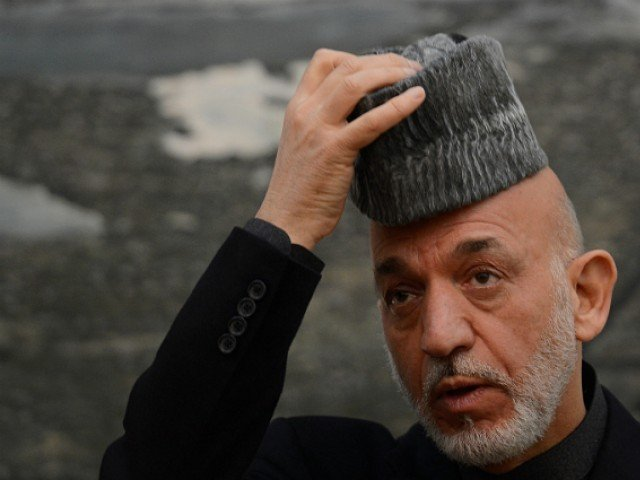 "Karzai had said the pact currently under consideration by a loya jirga, a meeting of tribal chieftains, could only be signed ""when our elections are conducted, correctly and with dignity"". PHOTO: AFP/FILE"