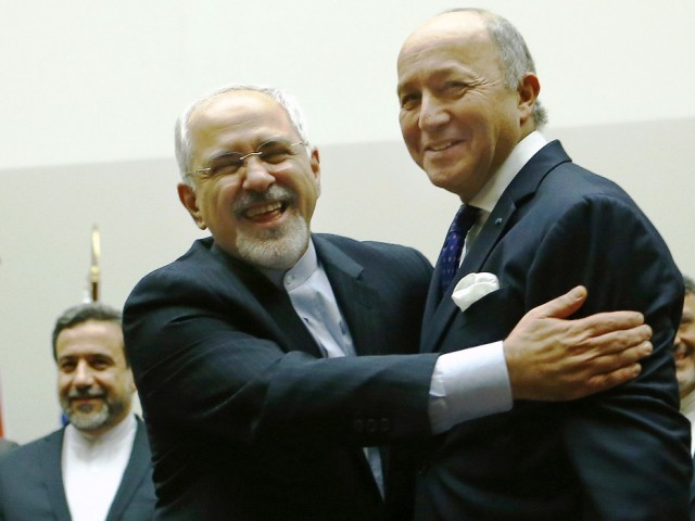 Iranian Foreign Minister Mohammad Javad Zarif hugs French Foreign Minister Laurent Fabius after a ceremony at the United Nations in Geneva November 24, 2013. photo: reuters
