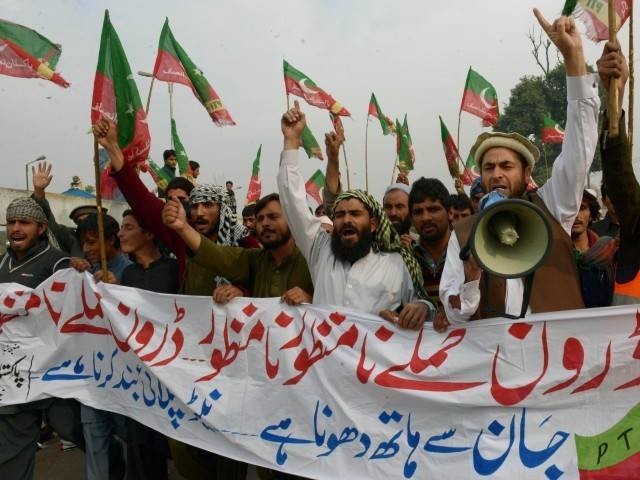 Activists of Pakistan Tehreek-e-Insaaf (PTI) shout slogans as they arrive to attend a protest rally in Peshawar on November 23, 2013. PHOTO: AFP