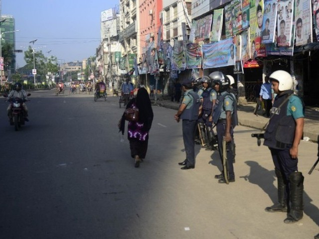 Bangladeshi police personnel stand guard during the second day of a nationwide strike called by the opposition BNP in Dhaka. PHOTO: AFP