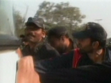 Express News screengrab of policemen pushing a bus to unblock a road.