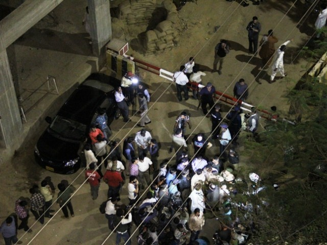 A crowd gathers at the front of the Express News office after the attack. PHOTO: AYESHA MIR/EXPRESS