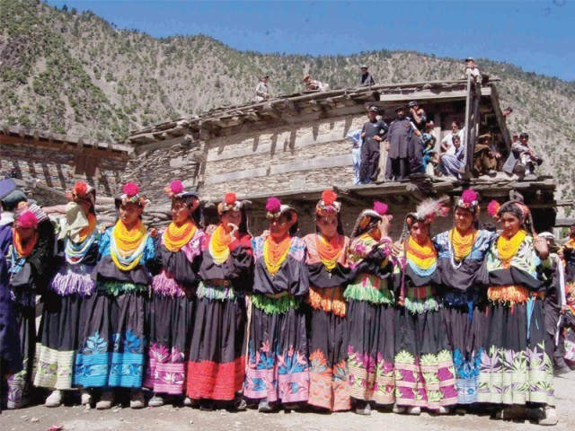 Kalash women gather at the Charsue, a customary dancing ground in Bumburet Valley. PHOTO: EXPRESS