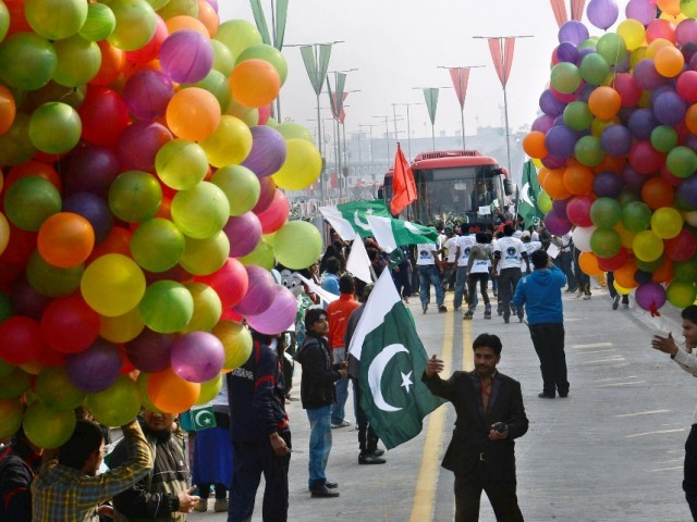 youth hold balloons during the launch of the Metro Bus system in Lahore on February 10, 2013. PHOTO: AFP