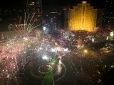 Fireworks explode over Hotel Indonesia Roundabout in Jakarta to celebrate the New Year on January 1, 2014. A wave of pyrotechnic displays kicked off new year celebrations in major cities around the world. PHOTO: AFP