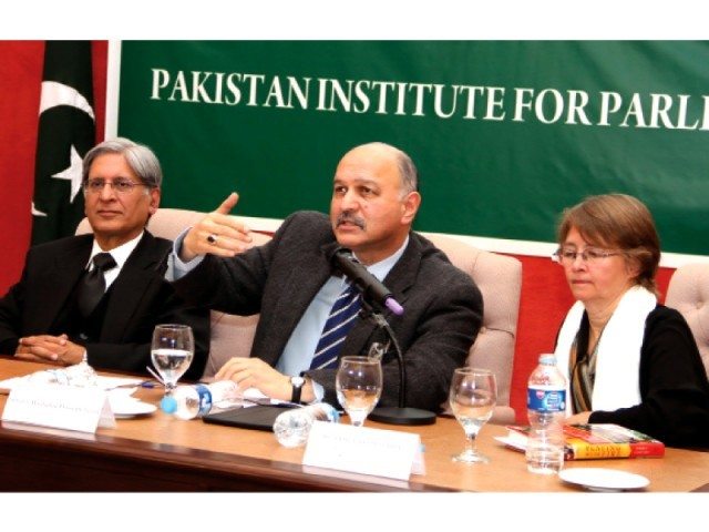 Senator Mushahid Hussain speaks at a seminar defence development and democracy. PHOTO: EXPRESS