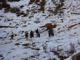 A flock of tourists enjoy snow at the valley. PHOTO: FAZAL KHALIQ