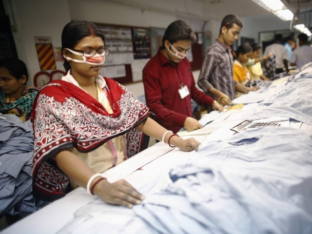 Employees work in a factory of Babylon Garments in Dhaka January 3, 2014. PHOTO: REUTERS