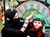 A mother and child in Hyderabad getting in the spirit to commemorate the birth of our Prophet (PBUH). PHOTO: APP