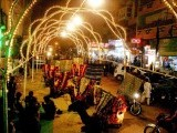 Camels sit under a lights in Karachi ahead of Eid Miladun Nabi (pbuh). PHOTO: INP
