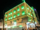 Green and yellow lights illuminate a school building in Karachi. PHOTO: MOHAMMAD NOMAN/EXPRESS