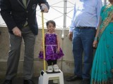 "jyoti Amge from Nagpur, India, is measured by a Guinness World Record official on top of the Empire State Building in New York, September 12, 2013. Standing 24.7 inches tall, Amge has held the title of the ""Shortest Living Woman"" since her 18th birthday on December 16, 2011. PHOTO: REUTERS"