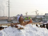 Jin Songhao drinks beer as he sits in snow during a cold endurance performance in Yanji, Jilin province, January 12, 2013. Jin set the Guinness record for the longest time spent in direct full body contact with snow on January 17, 2011 with a time of 46 minutes and seven seconds, local media reported. PHOTO: REUTERS