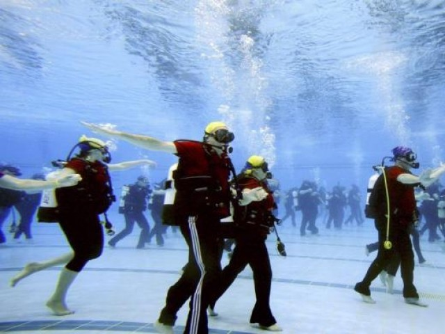 Seventy-four scuba divers dance to set the world record for an underwater dance class at Sydney's Olympic Park Aquatic Centre in 2006. The divers were required to dance simultaneously for ten minutes to set the record. PHOTO: REUTERS