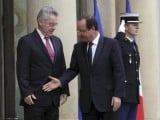 Trying too hard: Austrian President Heinz Fischer looks less than impressed with Hollande's outstretched efforts to shake hands. PHOTO: RUETERS
