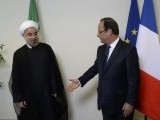 Snub: Iranian President Hassan Rouhani, pictured with the French leader looks unenthusiastic about shaking Hollande's hand. PHOTO: AFP