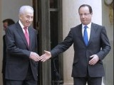 Off timing: Though France and Israel enjoy cordial relations, there has been an uncharacteristic chill about it in recent times exemplified by this tender handshake between Hollande and Israeli President Shimon Peres. PHOTO: REUTERS