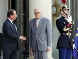 Not interested: Hollande extends a French welcome to Algerian United Nations envoy Lakhdar Brahimi - who looks like he seems to not have forgotten any of the history between the two countries, some of which he would have lived through as a youngster. PHOTO: AFP