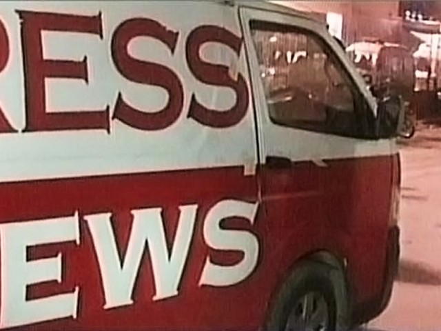 The digital satellite news gathering (DSNG) of Express News in which three men were killed in the attack. PHOTO: EXPRESS